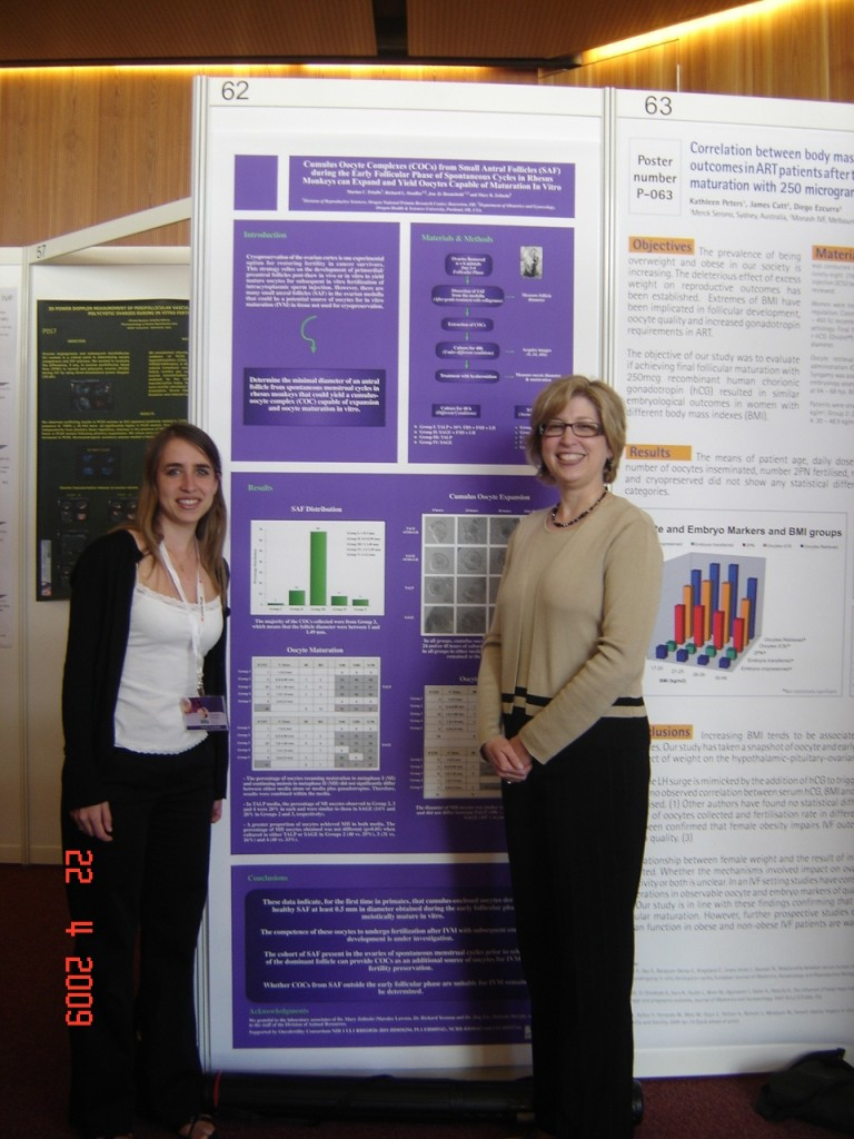 Marina Peluffo and Teresa Woodruff stand in front of the abstract poster Peluffo won an award for at the 15th World Congress on IVF in Geneva, Switzerland in April 2009.
